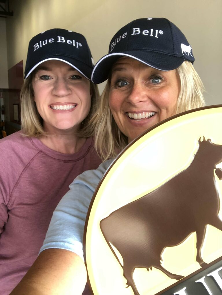 owner kassie and friend wearing bluebell hats, and holding a bluebell lid
